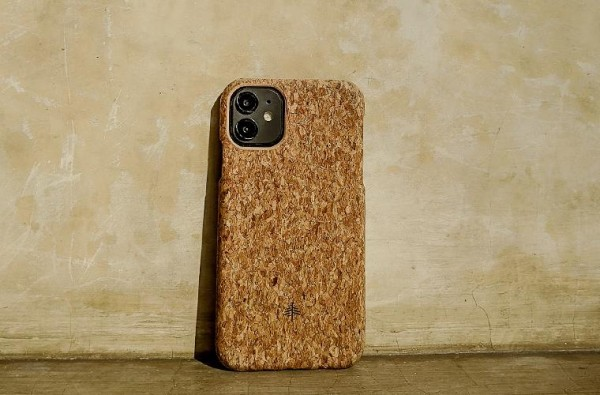 Cork phone case in front of wall
