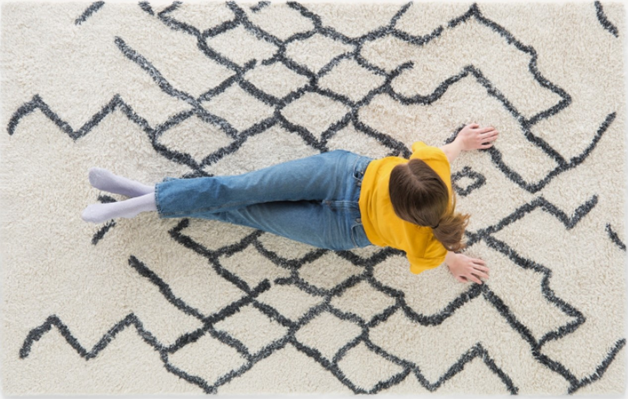 White organic carpet without harmful substances with dark details