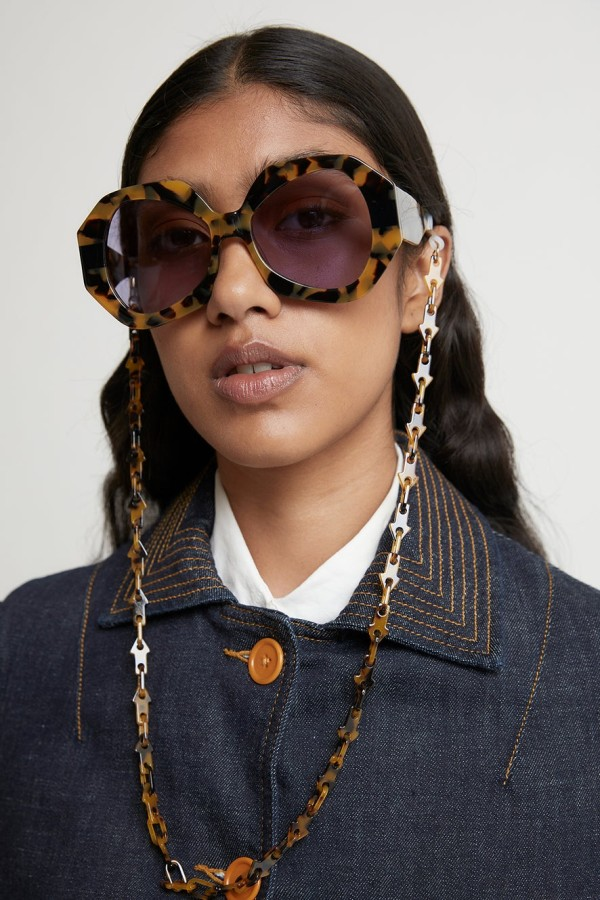 Woman wearing Karen Walker Eyewear sunglasses