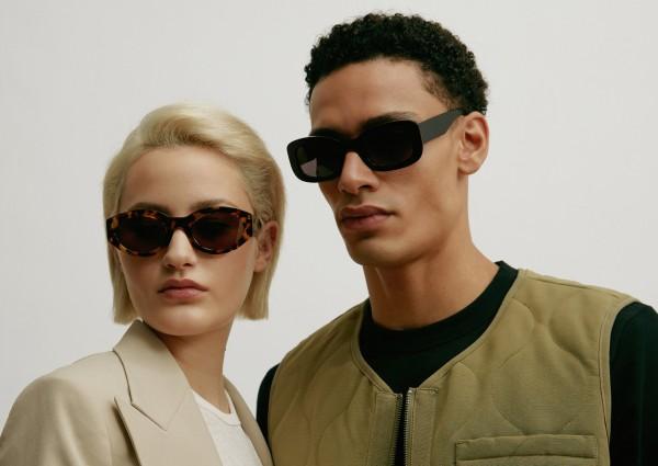 A man and a woman each wear Viu sunglasses
