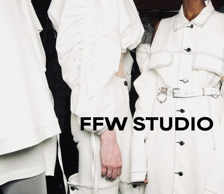 Three models in white outfits with the heading FFW Studio